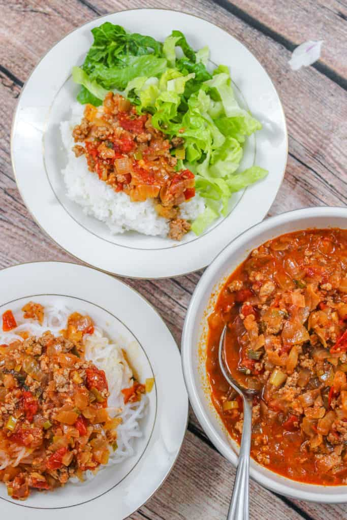 Vietnamese Ground Pork in Tomato Sauce (Thịt Băm Sốt Cà Chua) served with rice and lettuce, noodles
