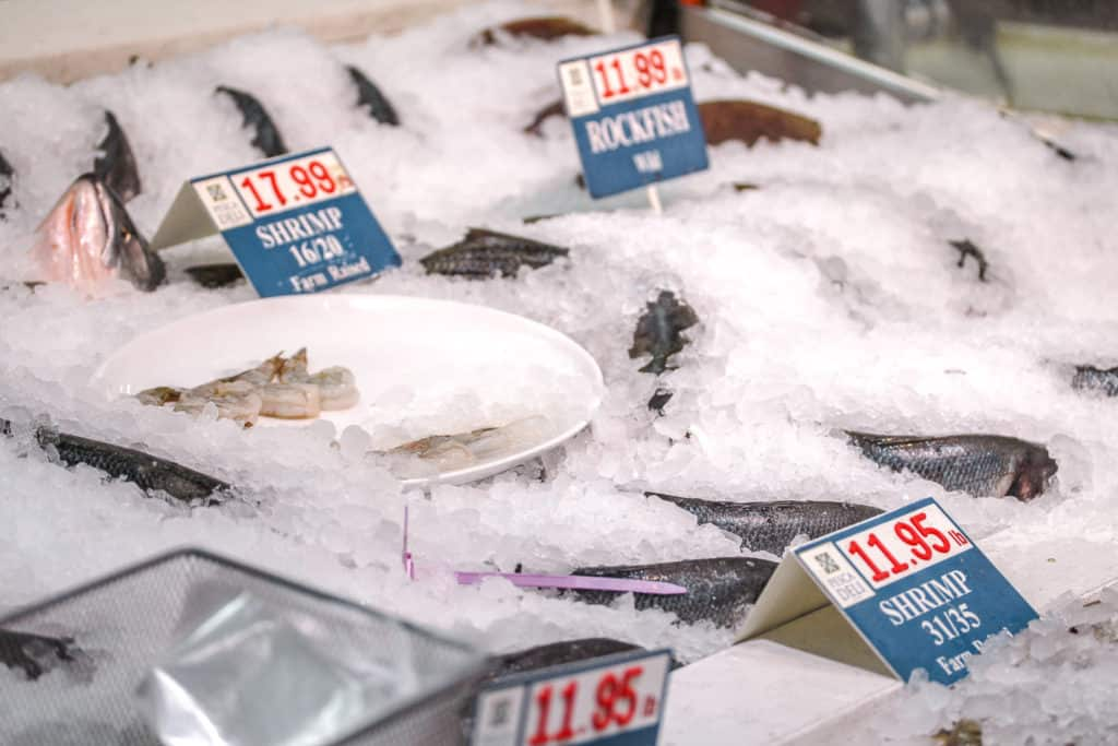 whole fish in ice at a display in pescadeli