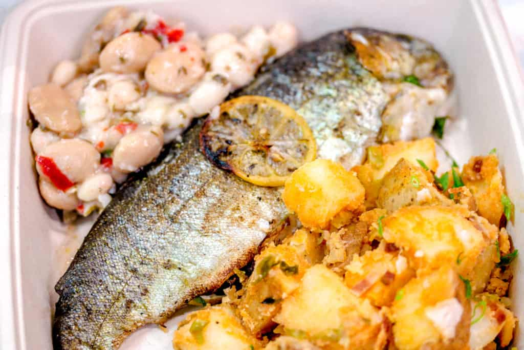 whole grilled fish, spicy potatoes and bean salad