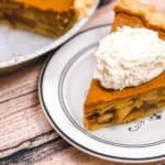 slice of pumpkin apple pie with whipped cream on top
