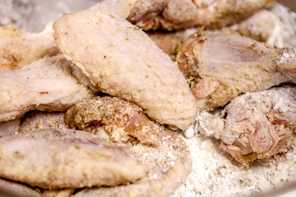seasoned chicken wings coated in corn starch