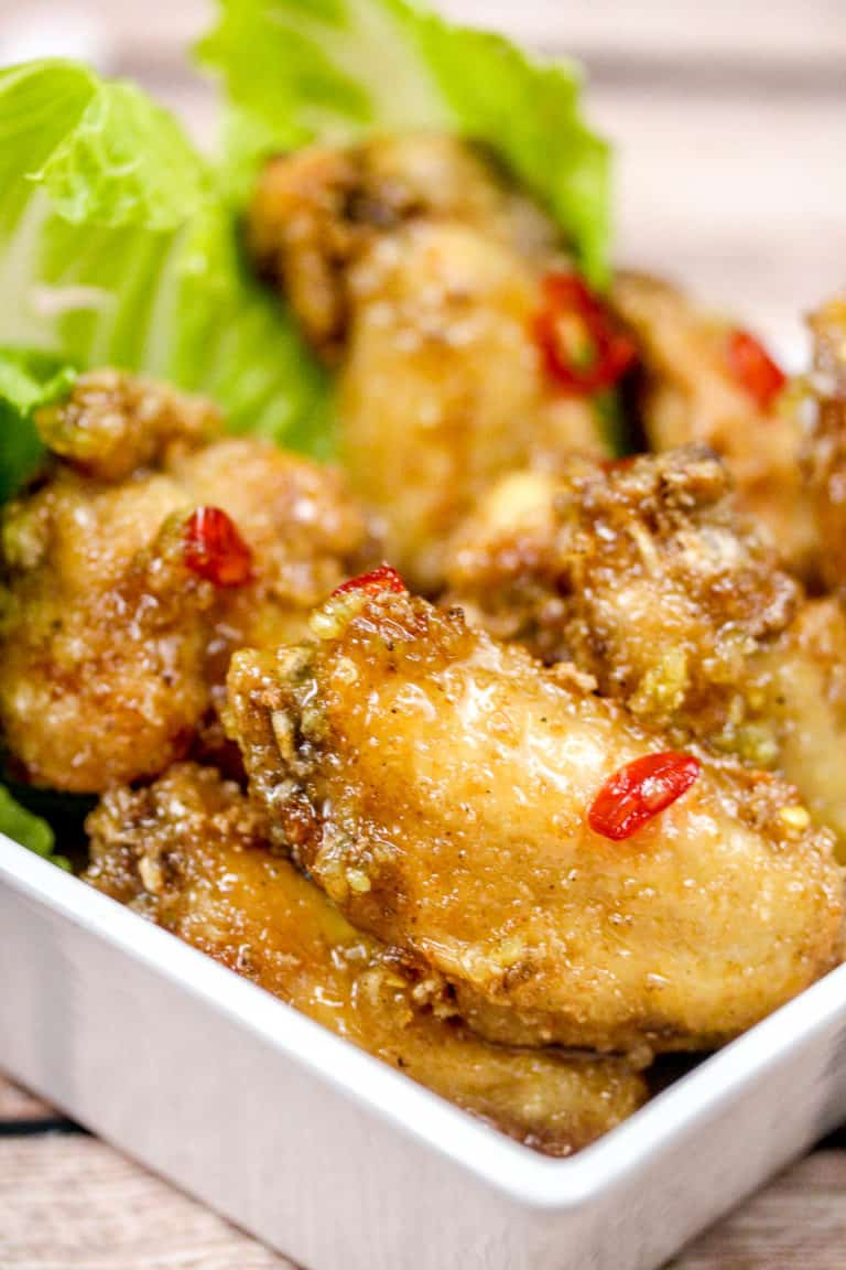 Chicken wings in a bowl with romaine lettuce