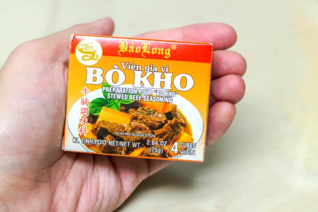 hand holding rectangular bouillon bos that says bo kho