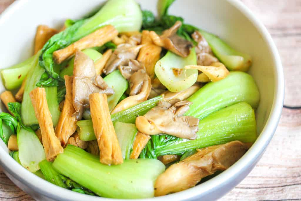 blue and white boy with oyster mushrooms, bok choy and tofu skin inside