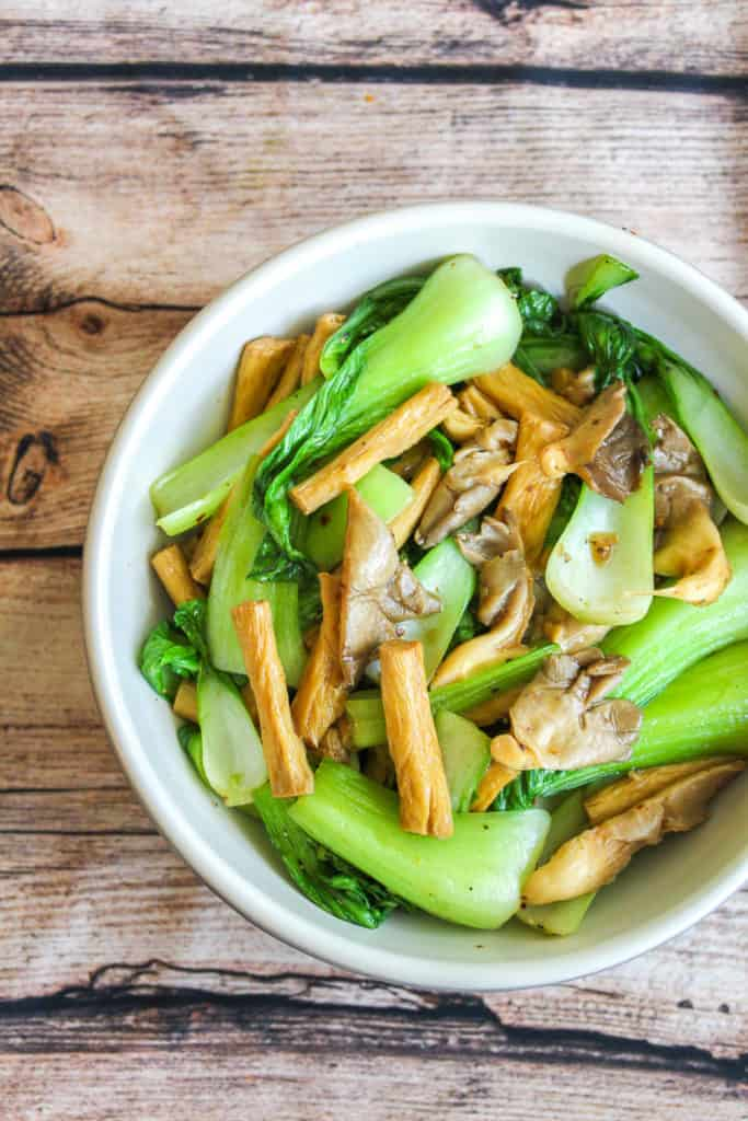 white bowl with tofu skin, bok choy and oyster mushrooms
