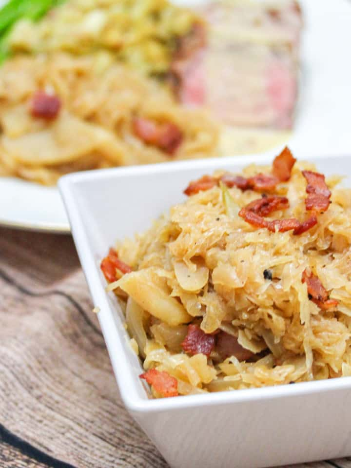 white square bowl with braised saurkraut and bacon
